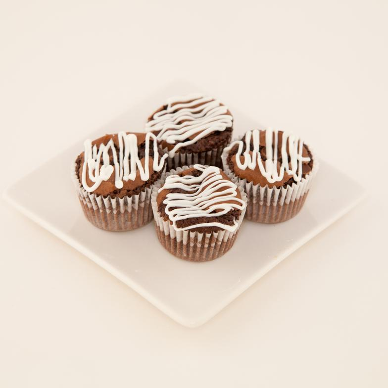 Individual triple chocolate brownies (tarlet size) drizzled with white chocolate