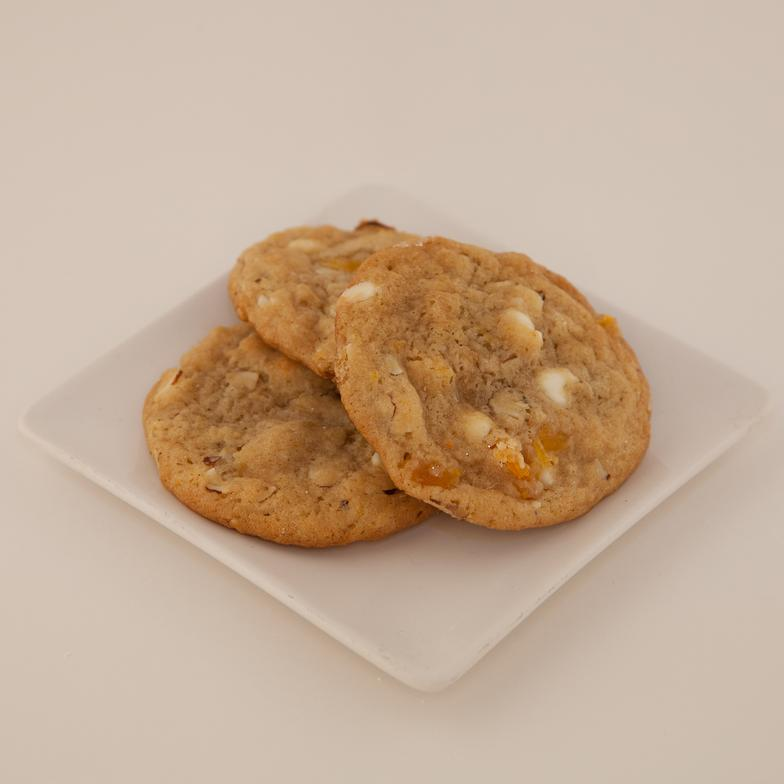 A sweet orange zest flavored cookie with nutty macadamias and white chocolate chips